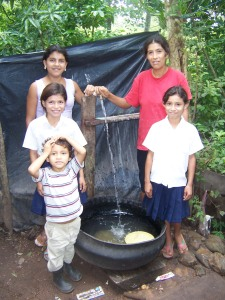 This family uses an inside-out tire to collect water for bathing and washing clothes.