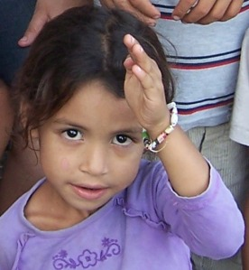 A Daisy-aged girl with her bracelet.